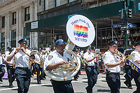 NYPD marching band in the annual Lesbian, Gay, Bisexual,Transgender and Queer (LGBTQ) Pride Parade on Fifth Avenue in New York on Sunday, June 25, 2017. Besides the corporate sponsors, politicians and various social service groups many participants carried political themed signs showing their dissatisfaction with President Trump. (© Richard B. Levine)