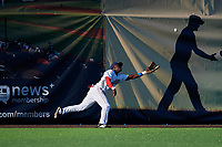 Auburn Doubledays left fielder Caldioli Sanfler (31) attempts to catch a fly ball in the gap during a NY-Penn League game against the West Virginia Black Bears on August 23, 2019 at Falcon Park in Auburn, New York.  West Virginia defeated Auburn 8-1, the first game of a doubleheader.  (Mike Janes/Four Seam Images)