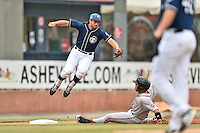 Asheville Tourists third baseman Josh Fuentes (21) leaps for the ball as Yoan Moncada (24) slides in safely at third during a game against the Greenville Drive on July 12, 2015 in Asheville, North Carolina. The Drive defeated the Tourists 9-3. (Tony Farlow/Four Seam Images)