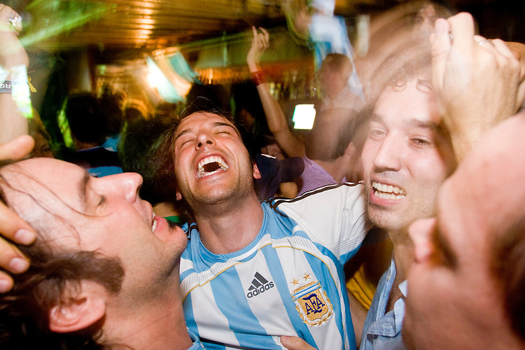 Argentina fans watch their team play Mexico in a World Cup match on June 24, 2006 at Novecento, a New York City restaurant.<br /> <br /> The World Cup, held every four years in different locales, is the world's pre-eminent sports tournament in the world's most popular sport, soccer (or football, as most of the world calls it).  Qualification for the World Cup is open to any country with a national team accredited by FIFA, world soccer's governing body. The first World Cup, organized by FIFA in response to the popularity of the first Olympic Games' soccer tournaments, was held in 1930 in Uruguay and was participated in by 13 nations.    <br /> <br /> As of 2010 there are 208 such teams.  The final field of the World Cup is narrowed down to 32 national teams in the three years preceding the tournament, with each region of the world allotted a specific number of spots.  <br /> <br /> The World Cup is the most widely regularly watched event in the world, with soccer teams being a source of national pride.  In most nations, the whole country is at a standstill when their team is playing in the tournament, everyone's eyes glued to their televisions or their ears to the radio, to see if their team will prevail.  While the United States in general is a conspicuous exception to the grip of World Cup fever there is one city that is a rather large exception to that rule.  In New York City, the most diverse city in a nation of immigrants, the melting pot that is America is on full display as fans of all nations gather in all possible venues to watch their teams and celebrate where they have come from.