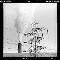 A smoke chimney and power lines are seen in Beijing, China January 2014. (Mamiya 6, 150mm, Kodak TRI-X film)