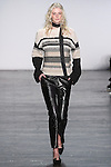"Model Lauren walks runway in a gream and grey mohair sweater with black trousers from the Vivienne Tam Fall Winter 2016 ""Cultural Dreamland The New Silk Road"" collection, presented at NYFW: The Shows Fall 2016, during New York Fashion Week Fall 2016."