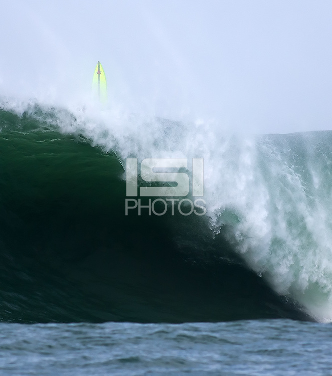 Half Moon Bay, California - January 24, 2014: 2014 Maverick's Invitational Anthony Tashnick attempts to pull out the back.