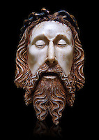 Gothic statue of the Head of Christ by  Jaume Cascalls. Carved alabaster with polychrome and gilt remains.  This head must have belonged to a Recumbent Christ which could have formed part of a sculptural group of the Holy Sepulchre. It probably came from the chapel of Corpus Christi of the convent of Sant Agust&iacute; Vell, Barcelona.<br />
