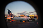 NEW YORK, NY -- AUGUST 13, 2015:  A United Airlines jet operated by United Continental Holdings Inc. is parked at gate C10 at La Guardia Airport on Thursday, August 13, 2015 in New York City. PHOTOGRAPH BY MICHAEL NAGLE