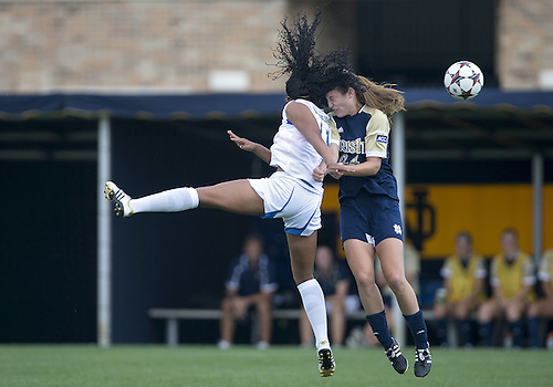 September 01, 2013:  UCLA forward Darian Jenkins (11) and Notre Dame defender Katie Naughton (24) battle for the ball during NCAA Soccer match between the Notre Dame Fighting Irish and the UCLA Bruins at Alumni Stadium in South Bend, Indiana.  UCLA defeated Notre Dame 1-0.