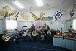 A Palestinian orphans play music in the SOS Children's Village in Rafah the southern Gaza Strip on June 30, 2009. The school for orphans that was established in 2000 with the sponsorship of the Austrian SOS international, faces the threat of closure because of the longstanding Israeli blockade on the Gaza Strip. Photo By Abed Rahim Khatib