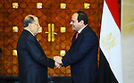 Egyptian President Abdel Fattah al-Sisi shakes hands with Lebanese President Michel Aoun during the a welcome ceremony at the Presidential palace in Cairo on February 13, 2017. Aoun started his first visit to Cairo since his election in October and held talks with Sisi and religious leaders. Photo by Egyptian President Office