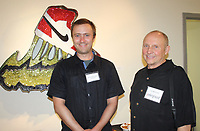 NWA Democrat-Gazette/CARIN SCHOPPMEYER Artist Dylan Mortimer (left) and Jay McDonald, Fayetteville Underground board member visit at the opening reception July 6 at the gallery.