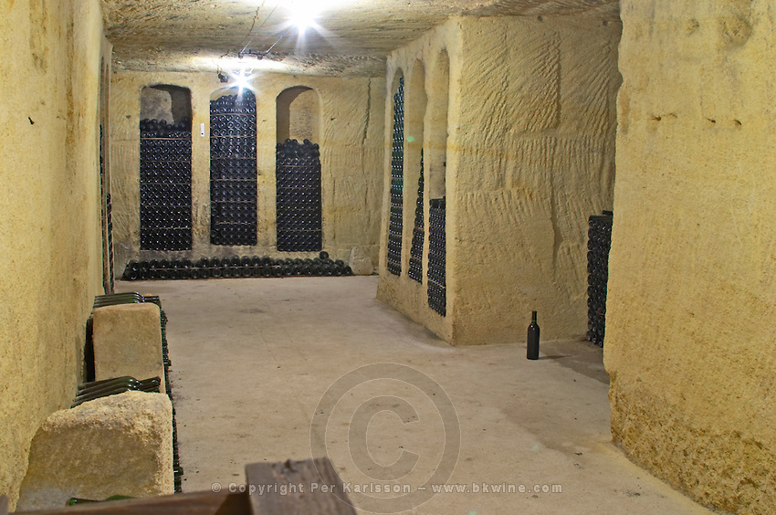 Bottles aging in the cellar. Clos Saint Julien, Saint Emilion, Bordeaux, France