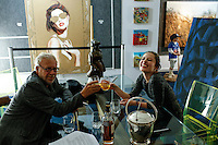 "Colombian Artist Evelin Velasquez (R ) cheers with American conceptual artis Joseph Kosuth, during the Opening of her solo Exhibit ""Transfigurations"" at the Fernando Luis Alvarez Gallery in Stamford 10.11.2014. Photo by Eduardo Munoz/VIEWpress"