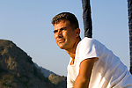 Turkish man sialing boat on Mediterranean Sea near bodrum