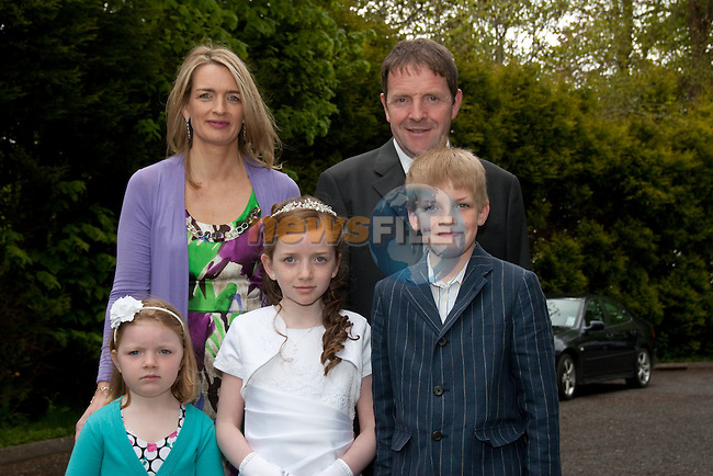 Thea Flanagan who made her First Communion Saturday in Termonfeckin Church pictured with her family Paul, Marguerite, Matthew and Ella. Picture: Newsfile/Mark Carroll.
