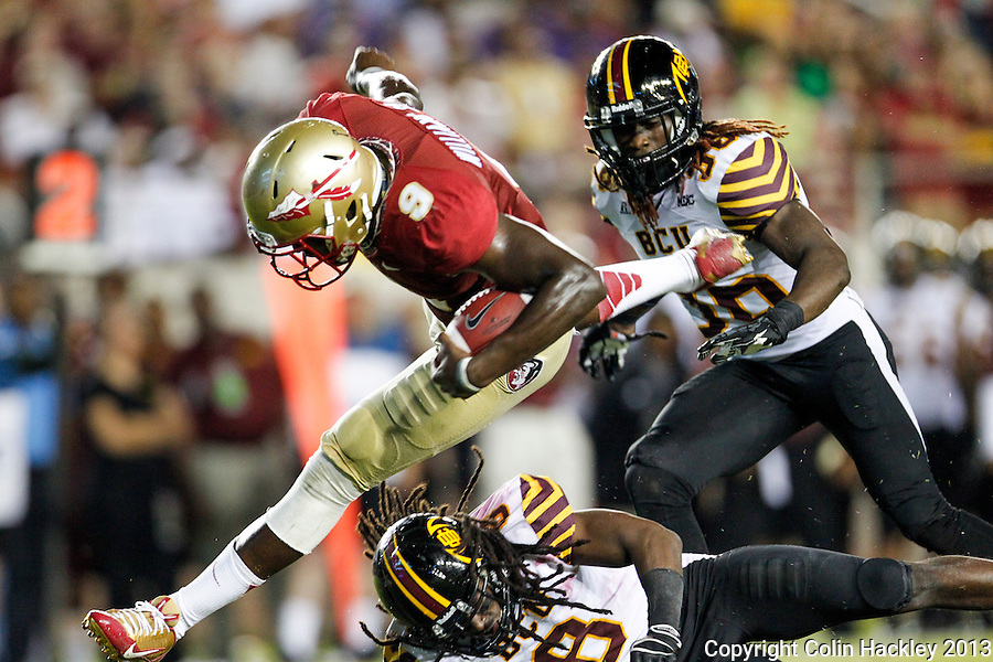 TALLAHASSEE, FLA 9/21/13-FSU-BCC092113CH-Florida State's Karlos Williams jumps over Bethune Cookman's Thomas Finnie during second half action Saturday at Doak Campbell Stadium in Tallahassee. The Seminoles beat the Wildcats 54-6.<br /> COLIN HACKLEY PHOTO