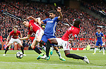 Ander Herrera and Eric Bailly of Manchester United combine to stop Diego Costa of Chelsea during the English Premier League match at Old Trafford Stadium, Manchester. Picture date: April 16th 2017. Pic credit should read: Simon Bellis/Sportimage