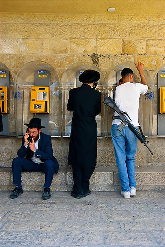 Jerusalem, Israel:  Guns and religion dominate the streets of the Old City.