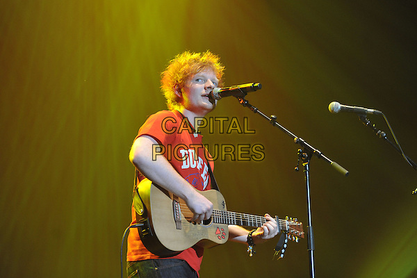 Ed Sheeran .Performing live at the 'Girlguiding UK  Big Gig' at Wembley Arena, London, UK, 1st October 2011..music concert  live on stage half  length red t-shirt guitar playing microphone singing .CAP/MAR.© Martin Harris/Capital Pictures.