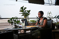 Woman works on a computer at the Bourbon Coffee Shop in Union Trade Center shopping mall in Kigali, Rwanda.