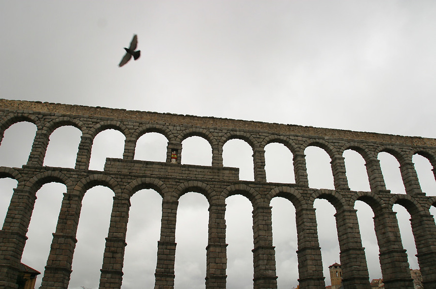 A pigeon and the Aqueduct bridge of Segovia, Spain, 2003.  Researchers have indicated that the Roman Aqueduct and it's bridge date back the the 2nd half of the 1st century and the early years of the 2nd century