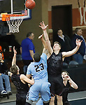 SIOUX FALLS, SD - MARCH 9:  Brandon Bell #23 of Warner Pacific shoots over Morningside defenders Matthew Hahn #24 and Tyler Borchers #33 at the 2018 NAIA DII Men's Basketball Championship at the Sanford Pentagon in Sioux Falls. (Photo by Dick Carlson/Inertia)
