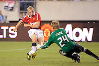 Ritchie De Laet (30) of Manchester United has his shot saved by Philadelphia Union goalkeeper Brian Perk (24). Manchester United (EPL) defeated the Philadelphia Union (MLS) 1-0 during an international friendly at Lincoln Financial Field in Philadelphia, PA, on July 21, 2010.