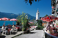 Austria, Upper Austria, Salzkammergut, St. Wolfgang at Lake Wolfgang: cafe with seaview and pilgrimage church St.Wolfgang