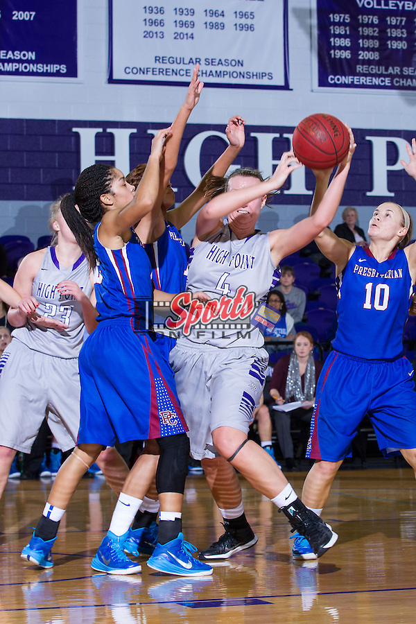 Stacia Robertson (4) of the High Point Panthers is surrounded by Presbyterian Blue Hose defenders during first half action at Millis Athletic Center on December 6, 2014 in High Point, North Carolina.  The Panthers defeated the Blue Hose 54-49.   (Brian Westerholt/Sports On Film)