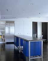 The custom-made steel-framed unit which separates the dining area from the kitchen doubles as a breakfast bar