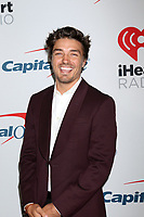 LOS ANGELES - JAN 18:  Dean Unglert at the iHeartRadio Podcast Awards at the iHeartRadio Theater on January 18, 2019 in Burbank, CA