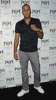 James DeGale.attended the Kensington Club new boutique nightclub launch party, The Kensington Club, High Street Kensington, London, England,.20th July 2012..full length grey gray trousers black t-shirt white trainers hand fists gesture .CAP/CAN.©Can Nguyen/Capital Pictures.