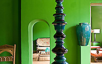 The library-cum-living room has been painted a vivid, bright green