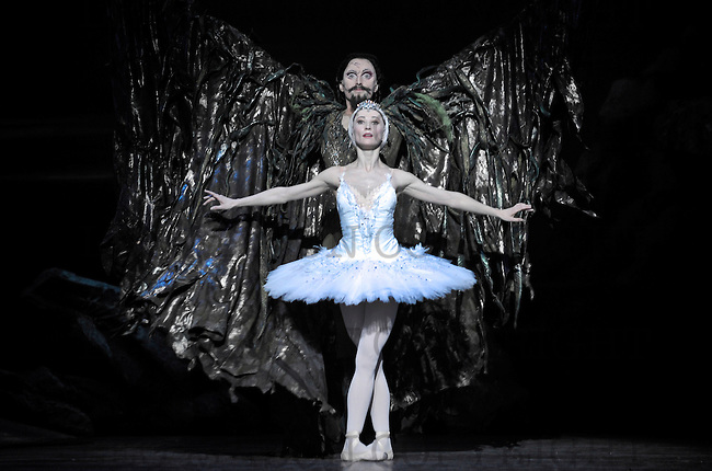 22.03.2011 Swan Lake performed by the English National Ballet Company at The Coliseum London Odette (Daria Klimentova) and Rothbart (Fabian Reimair