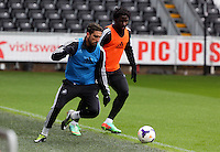 Wednesday, 23 April 2014<br /> Pictured L-R: Chico Flores and Wilfried Bony. <br /> Re: Swansea City FC are holding an open training session for their supporters at the Liberty Stadium, south Wales,