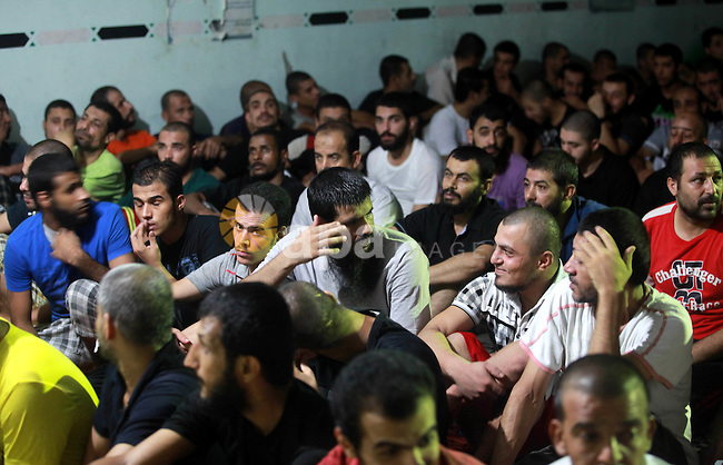 Palestinian inmates participate a prayer during the holy month of Ramadan at prison controlled by the Hamas police in Gaza city on 29 July 2012. Hamas police released more than 150 criminal inmates before the fasting month of Ramadan. Photo by Majdi Fathi