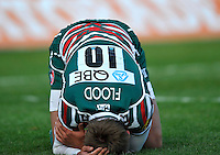 Leicester, England. Toby Flood of Leicester Tigers injures his arm during the Aviva Premiership match between Leicester Tigers and Harlequins at Welford Road on September 22, 2012 in Leicester, England.