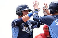 Tampa Bay Rays minor league outfielder Thomas Milone (27) after hitting a home run during an extended spring training game against the Boston Red Sox on April 16, 2014 at Charlotte Sports Park in Port Charlotte, Florida.  (Mike Janes/Four Seam Images)