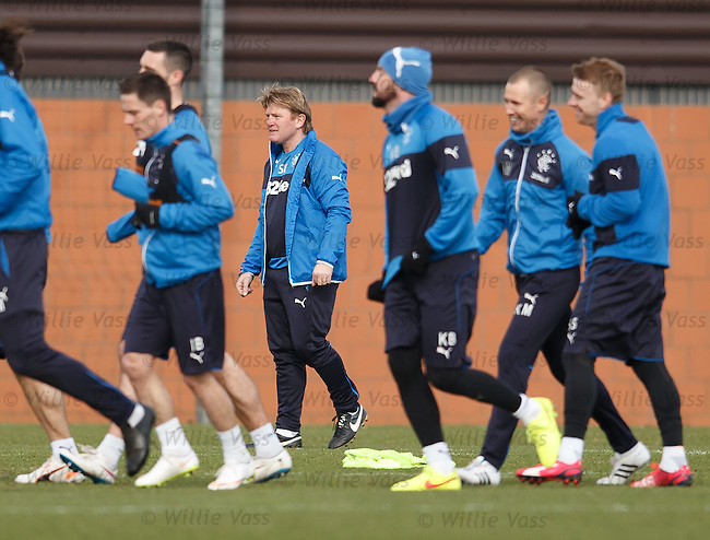 Stuart McCall gets the Rangers players moving at training