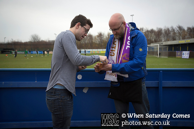 City of Liverpool 6 Holker Old Boys 1, 10/12/2016. Delta Taxis Stadium, North West Counties League Division One. A spectator buying a 'golden goal' ticket at the Delta Taxis Stadium, Bootle, Merseyside before City of Liverpool hosted Holker Old Boys in a North West Counties League division one match. Founded in 2015, and aiming to be the premier non-League club in Liverpool, City were admitted to the League at the start of the 2016-17 season and were using Bootle FC's ground for home matches. A 6-1 victory over their visitors took 'the Purps' to the top of the division, in a match watched by 483 spectators. Photo by Colin McPherson.