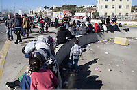 Pictured: Migrants gather at the port Monday 22 February 2016<br /> Re: Thousands of migrants, most from Syria, have landed to the port of Pireaus, after crossing the border from Turkey to various islands like Lesvos and Kos in Greece.
