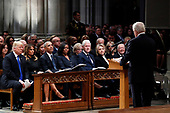 From left, President Donald Trump, first lady Melania Trump, former President Barack Obama, Michelle Obama, former President Bill Clinton, former Secretary of State Hillary Clinton, and former President Jimmy Carter listen as former Canadian Prime Minister Brian Mulroney speaks during a State Funeral at the National Cathedral, Wednesday, Dec. 5, 2018, in Washington, for former President George H.W. Bush.<br /> Credit: Alex Brandon / Pool via CNP