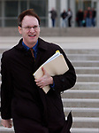 Newsday reporter, James Madore, as he leaves U.S. District Court in Central Islip on Thursday February 10, 2005. (Newsday Photo / Jim Peppler).