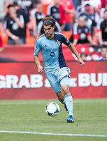 Graham Zusi (8) of Sporting Kansas City brings the ball upfield during a Major League Soccer match at RFK Stadium in Washington, DC.  D.C. United tied Sporting Kansas City, 1-1.
