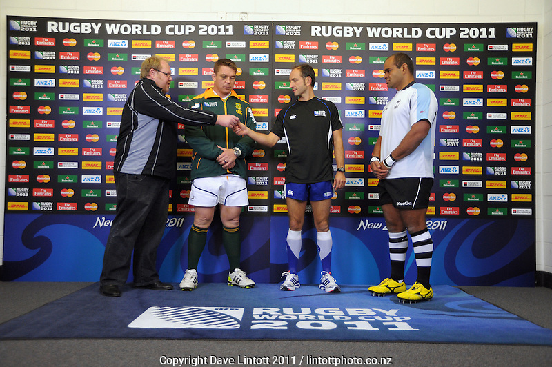 The team captains take the coin toss before the South Africa versus Fiji pool D match of the 2011 IRB Rugby World Cup at Wellington Regional Stadium, Wellington, New Zealand on Saturday, 17 September 2011. Photo: Dave Lintott / lintottphoto.co.nz