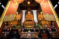 Golden Buddhas in the Grand Hall of Magnificence of the Jade Buddha Temple, Shanghai, China