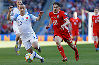 Daniel James of Wales (R) and Stanislav Lobotka of Slovakia in action during the UEFA EURO 2020 Qualifier match between Wales and Slovakia at the Cardiff City Stadium, Cardiff, Wales, UK. Sunday 24 March 2019
