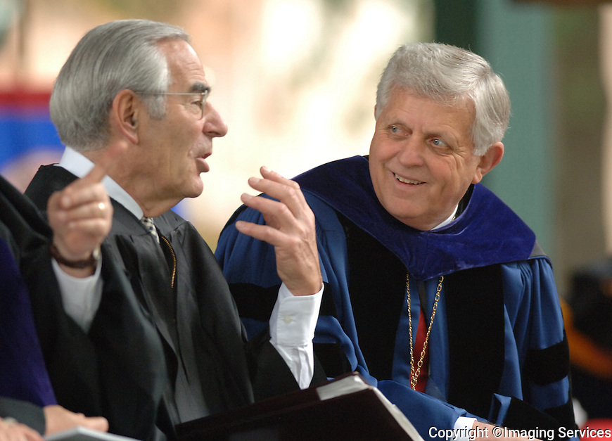 Journalist, author and historian David Halberstam (left) chats with University of Mississippi Chancellor Robert C. Khayat just before commencement ceremonies at The University of Mississippi Grove on Saturday May 14, 2005. (Robert Jordan/Associated Press)