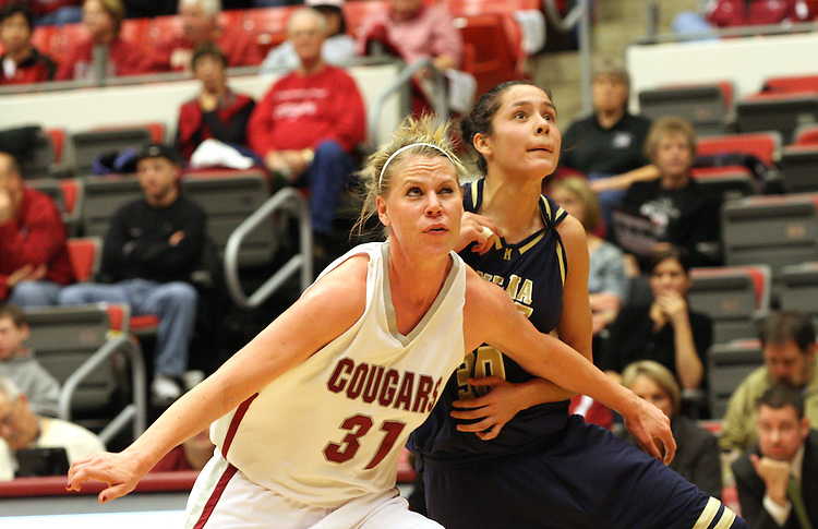 Heather Molzen (#31), Washington State senior, fights for rebounding position during the Cougars game against Montana State in Pullman, Washington, on November 23, 2008.  The Cougars prevailed in the contest, 78-66.