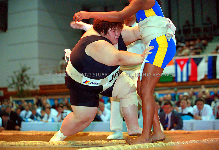 10/26/2001--Hirosaki, Aomori Prefecture, Japan.. Rie Tsuihiji pushes out Chagas Eric Sanusa at the World internationl sumo tournament...All photographs ©2003 Stuart Isett.All rights reserved.This image may not be reproduced without expressed written permission from Stuart Isett.