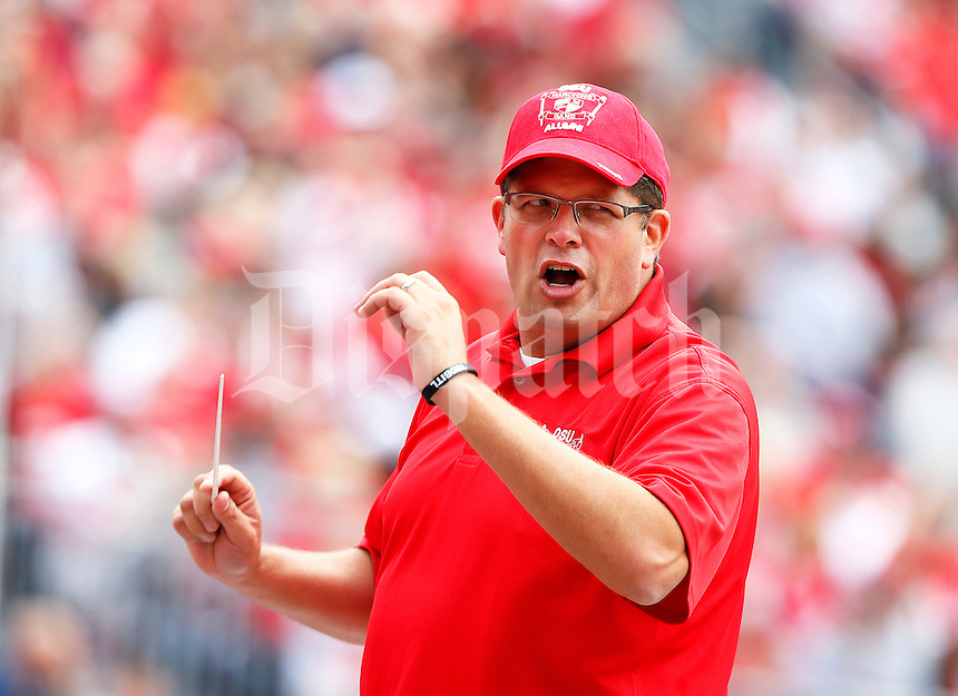 Former Ohio State marching band director Jonathan Waters conducts several songs for the alumni band during the game against Kent State, at Ohio Stadium in Columbus, Saturday, September 13, 2014. (Dispatch Photo by Jenna Watson)