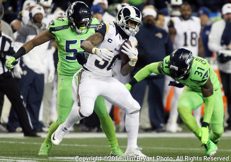 Los Angeles Rams running back Todd Gurley (30) is run down for a 7-yard loss by Seattle Seahawks outside linebacker Mike Morgan (57) and strong safety Kam Chancellor (31) at CenturyLink Field in Seattle, Washington on December 15, 2016.  The Seahawks beat the Rams 24-3.  ©2016. Jim Bryant Photo. All Rights Reserved